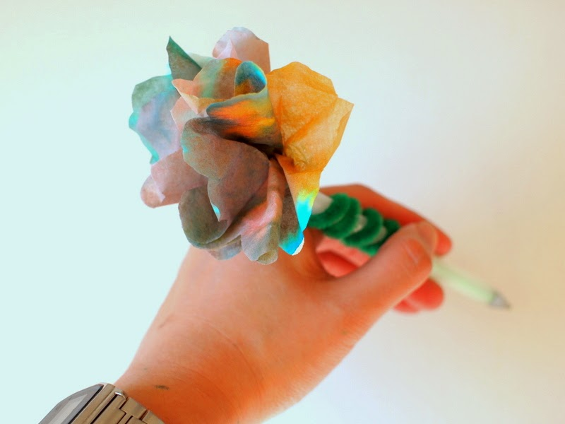 Twirl coffee filter flower around pen