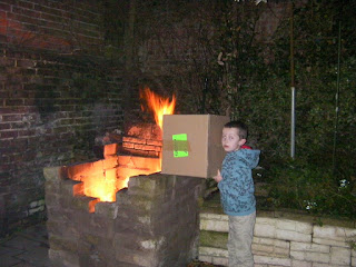 boy with fire and cardboard box