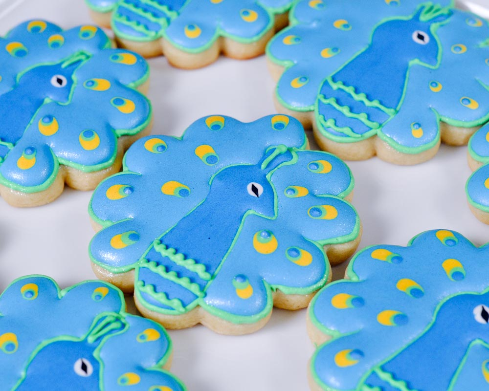 these peacock cookies were made for a baby shower when she asked me to make them i was nervous but then i found the inspiration for these cookies from