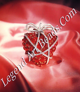 A ruby and diamond wrapped heart brooch, 1949.