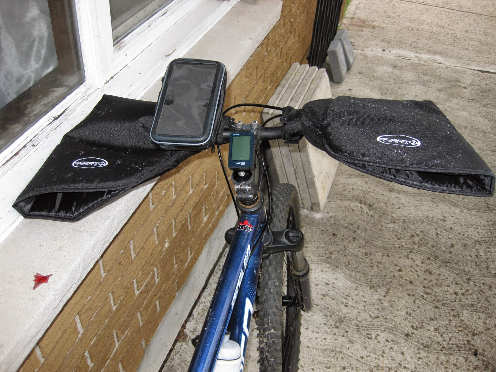 Pogies on the handlebars with a smartphone mount for a large smartphone.