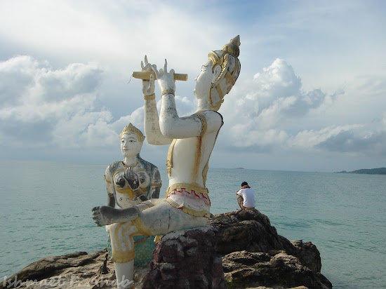 Praying on the rocks of Koh Samet Island