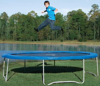 kid jumping on a pure fun 14 foot outdoor trampoline