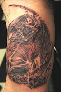Grim Reaper - Angel of Death tattoo - a skeleton with huge bat-wings