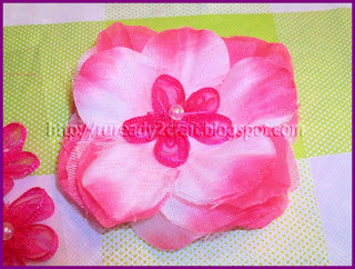 Shades of pink flower center in luau flower petal hair bow