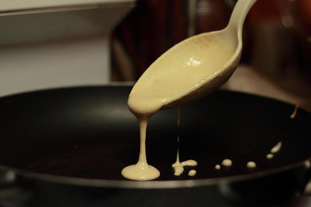 pouring pancake batter