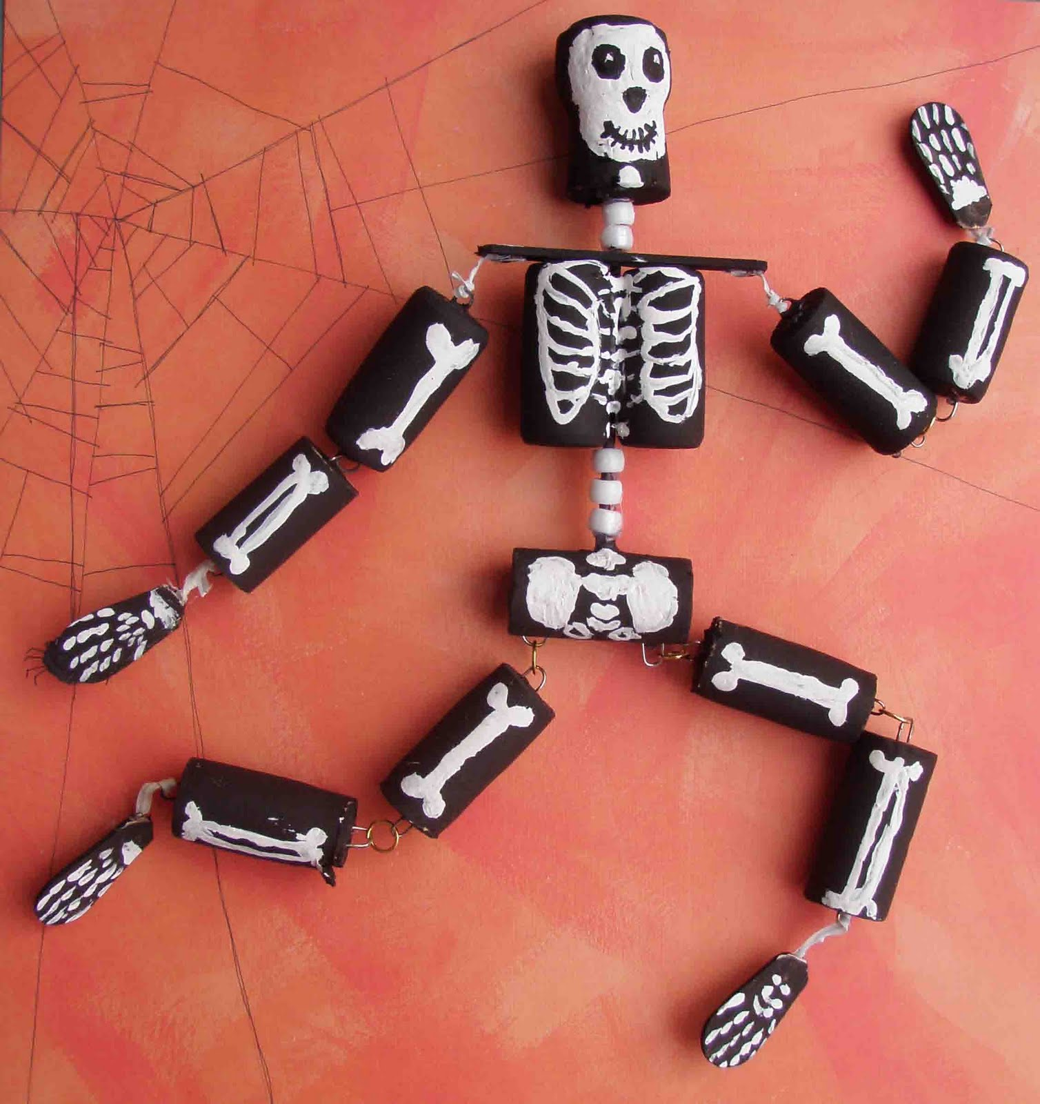 Wine bottle corks crafts - Skeleton Man Was Made From 11 Wine Corks And One Champagne Cork Skull His Backbone Is A Bamboo Skewer Fitted With Pony Bead Vertebrate