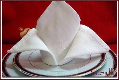 doblado de servilletas sombrero del cardenal