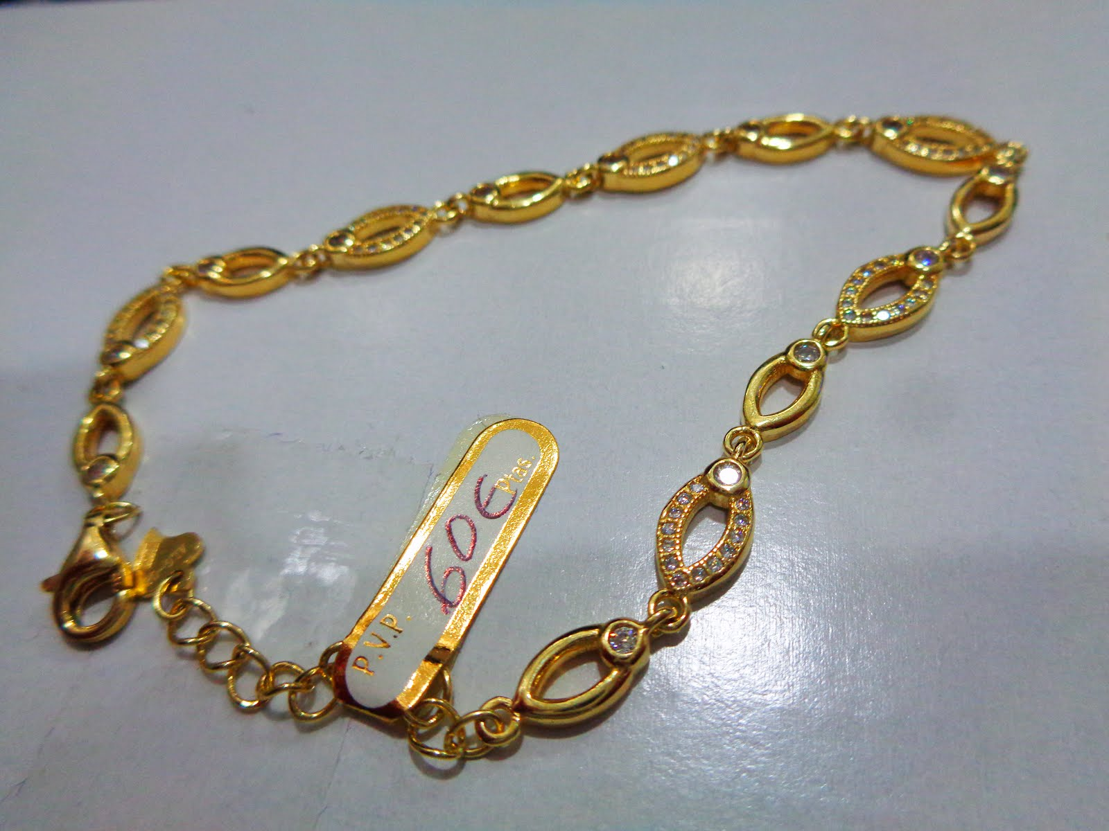 Pulsera plata dorada con circonitas