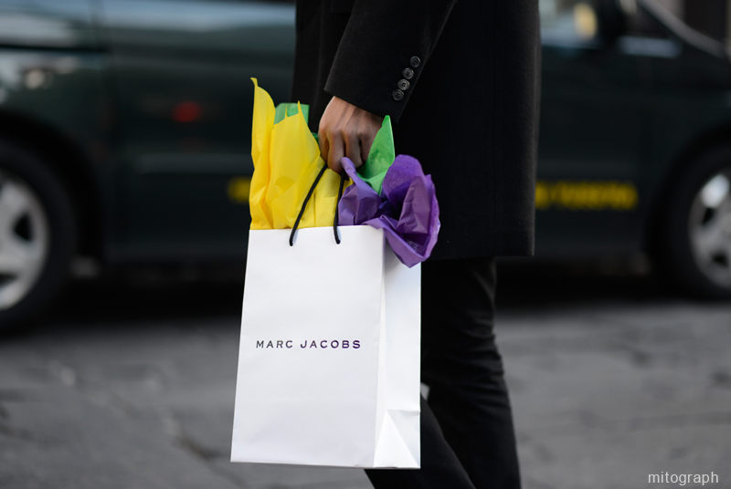 man carrying Marc Jacobs gift wrapping shopping bag at New York