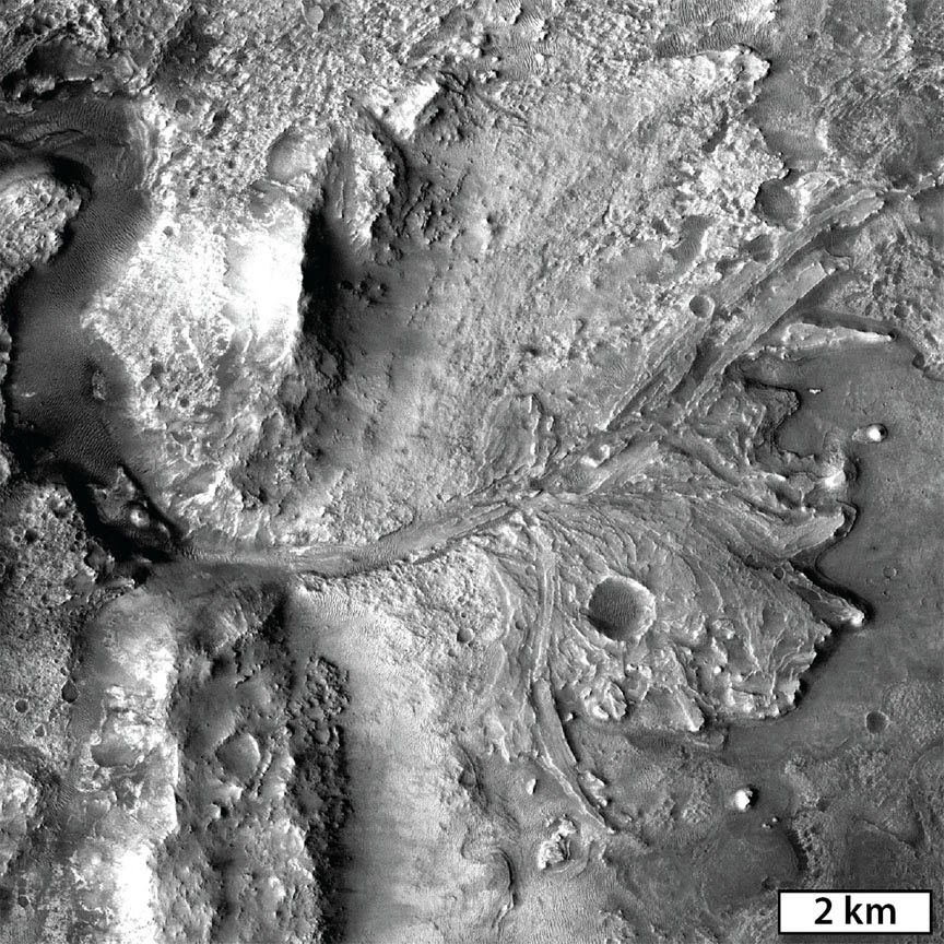 A delta-like fan at the western edge of Jezero Crater marks an area where flowing water would have entered the lake-filled crater and deposited clay minerals transported from the surrounding watershed. Credit: NASA/MSSS