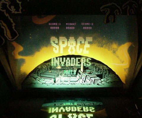 Space Invaders using a half-silvered / two-way mirror effect.