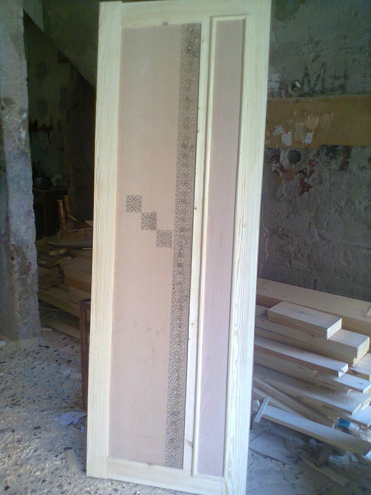 Les portes en bois for Film marocain chambre 13 en ligne