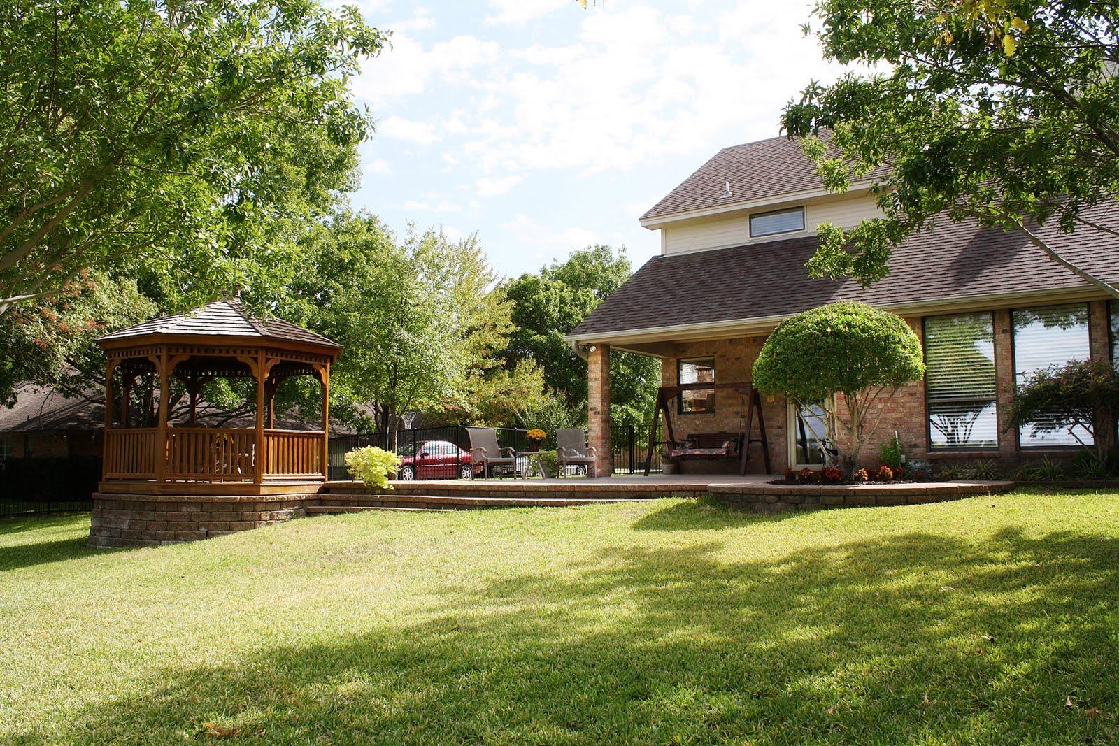 backyard golf course view with gazebo