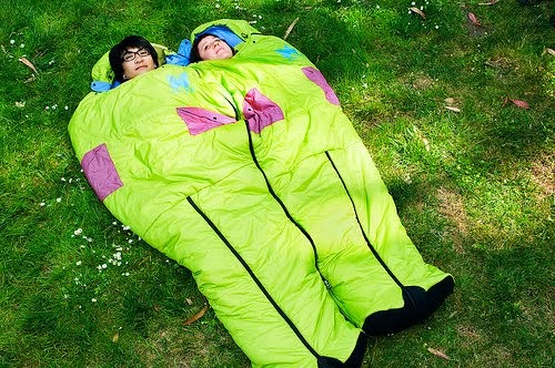 romantic camping in a sleeping bag