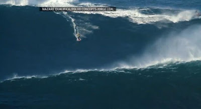 Surfer Garrett McNamara rides world's biggest wave in Nazare Canyon, Portugal - Travel Europe Guide (picture 1)