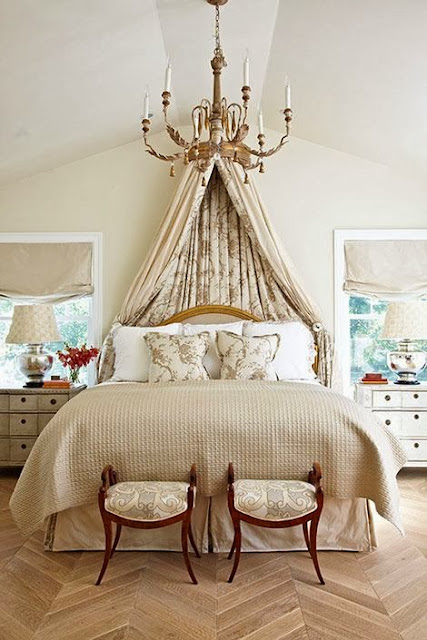 large white walls master bedroom gold accents beige neutral furniture canopy bed