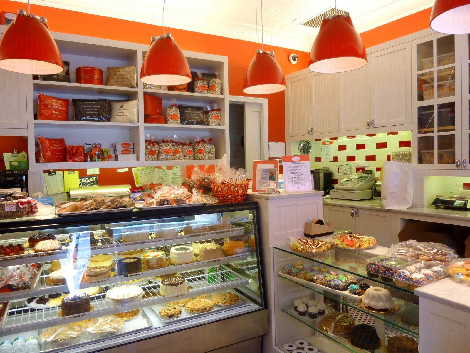 Bizzy oven mitt bakery bakery interiors for Bakery decoration