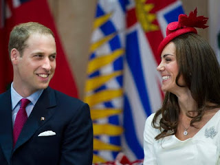 William and Kate, the Duke and Duchess of Cambridge, share a laugh during a citizenship ceremony at the Museum of Civilization in Gatineau, Canada, on Friday, July 1, 2011.