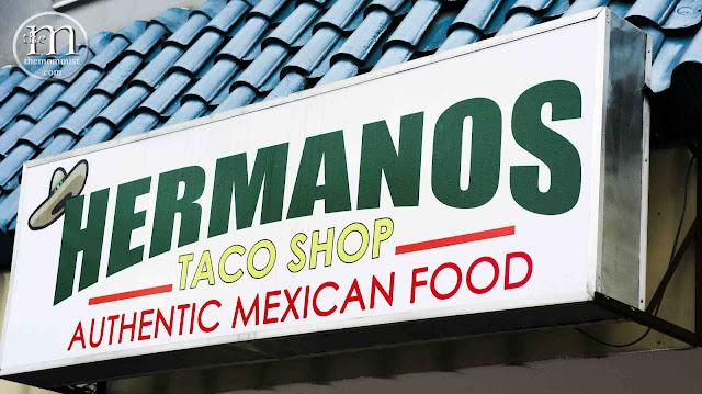 Hermanos Taco Shop signage