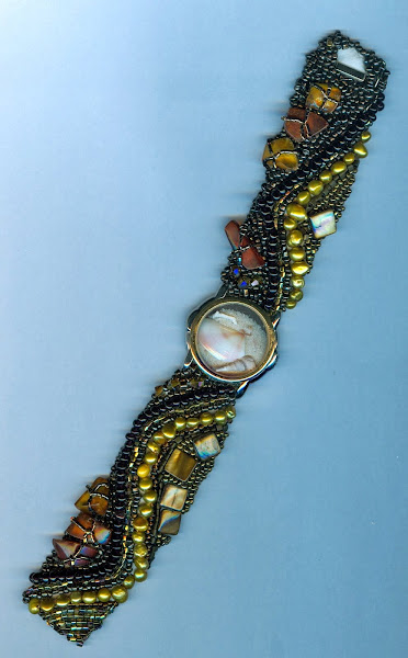 cuff with sand and shells in watch face