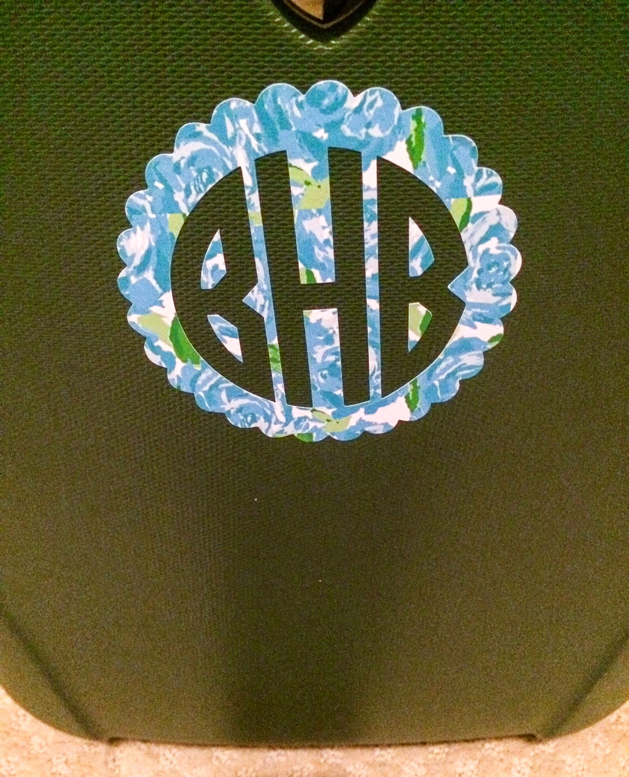 lilly pulitzer monogram on a suitcase first impression