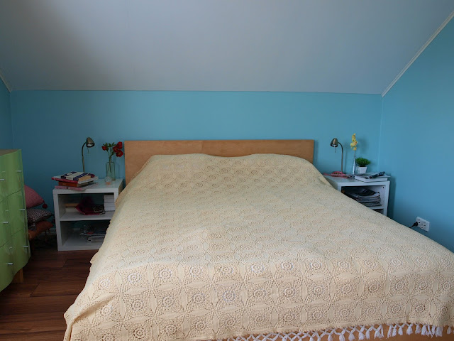 vintage bedroom makeover turquoise blue bright ikea mirrored frame croched bedspread