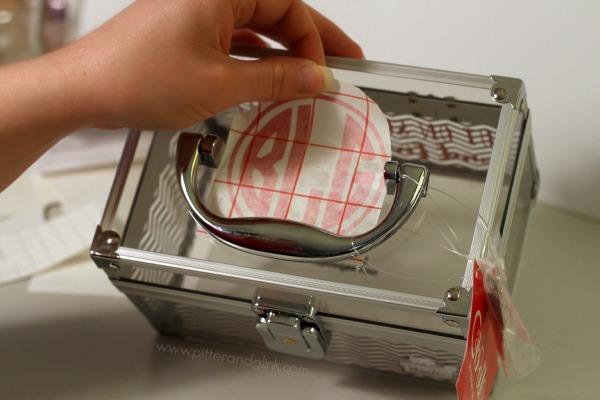 Adhere a vinyl monogram to a plain makeup case to personalize it.  www.pitterandglink.com
