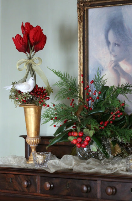 Fresh greenery Christmas vignette on the empire chest.