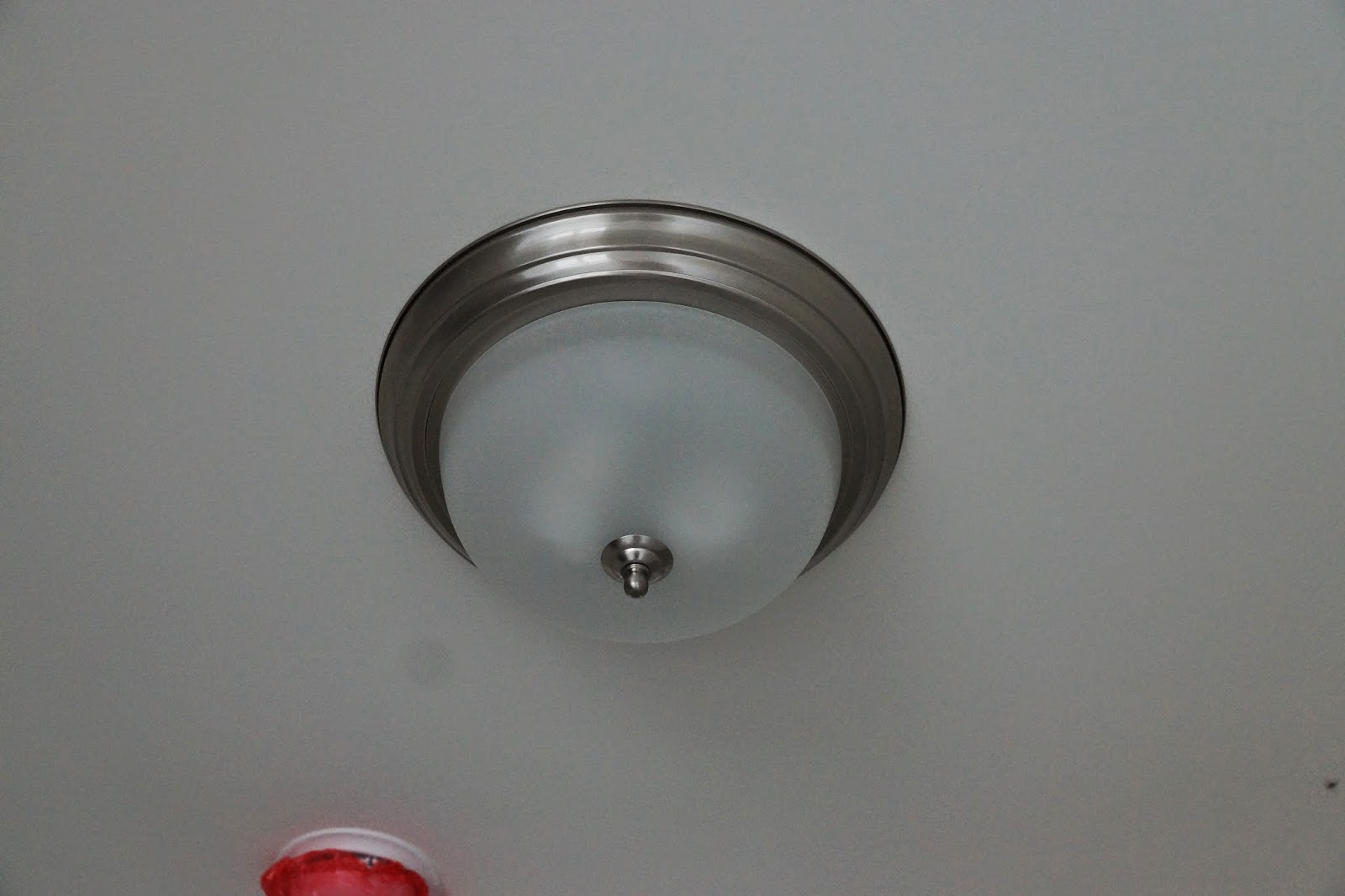 A picture of light fixture used in the open areas of the house
