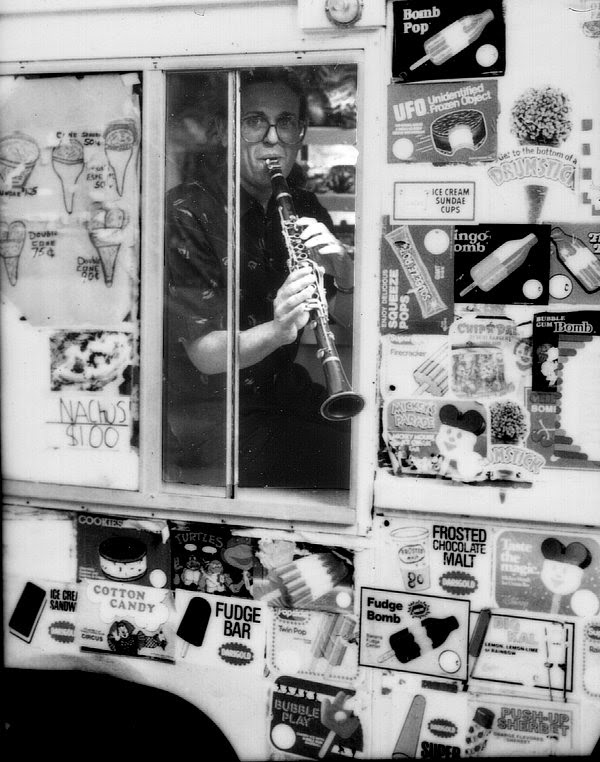 David Ocker plays the clarinet through the window of a real genuine ice cream truck