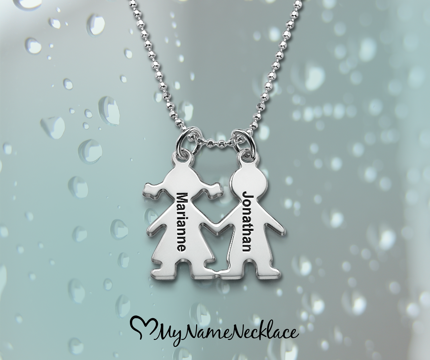 Have a reminder of your children wherever you go with our beautiful Kids Holding Hands Charms Necklace. It features two children with interlocking arms.