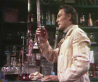 Jack Palance as Dr. Jekyll in an early lab scene