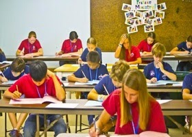 Students in a classroom during examinations.