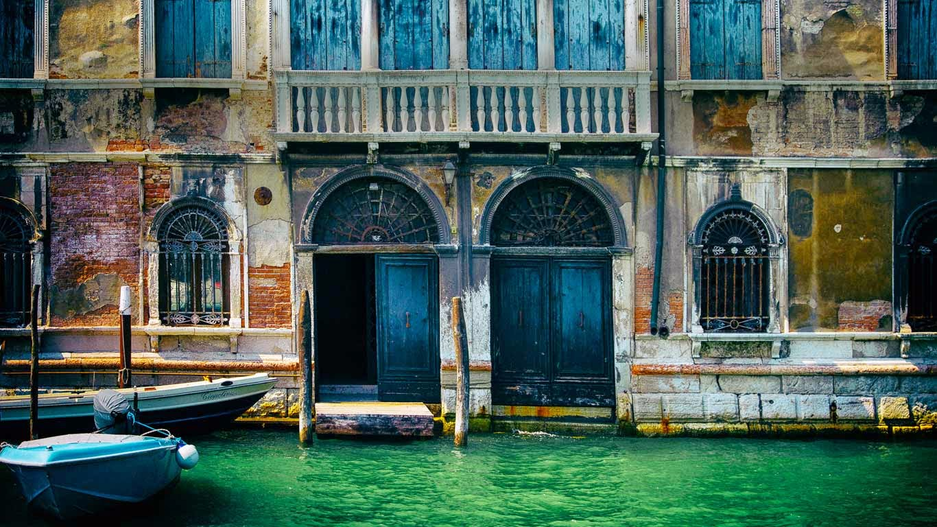 Building façade and canal in Venice, Italy (© Jim C. Martin) 143