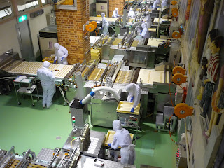 Factory floor at the Shiroi Koibito Park with many rows of biscuit making machines