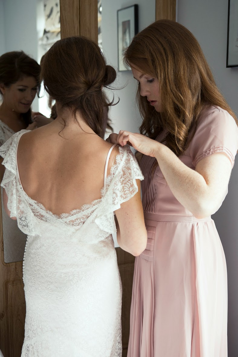 Heavenly Vintage Wedding Blog - Original vintage wedding, Jennifer putting on the dress