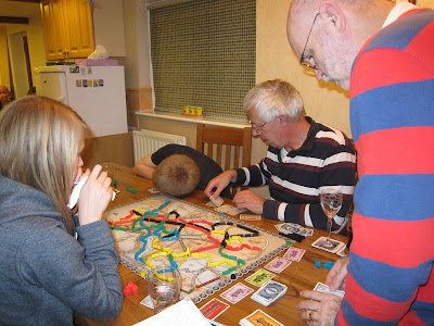 Ticket To Ride: Europe - The players with what looks like one listening for the train coming down the track!!