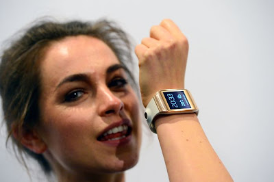 A woman taking a call with a smartwatch