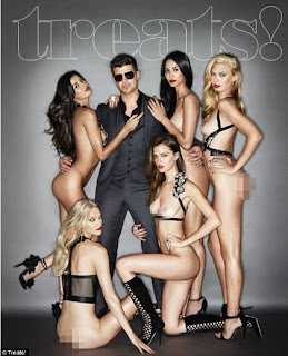 Oh My God ! Married singer Robin Thicke poses with naked women for Treat! mag
