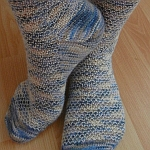 http://www.ravelry.com/projects/yacurama/broken-seed-stitch-socks