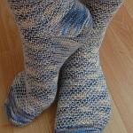 http://www.ravelry.com/projects/yacurama/broken-seed-stitch-socks