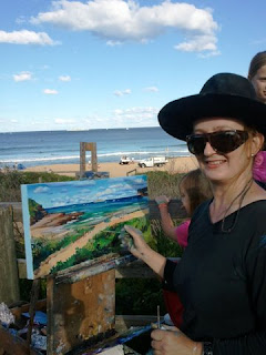 Industrial heritage artist Jane Bennett  painting the ex HMAS Adelaide en plein air on North Avoca Beach