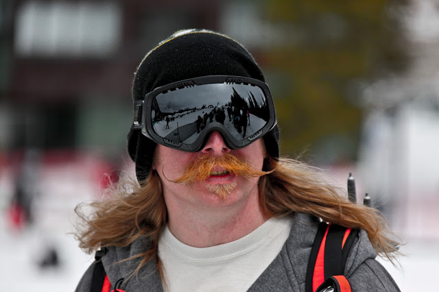 A guy at Copper Mountain with a big, red mustache and ski goggles.