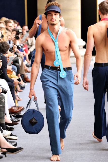Shirtless male models on the runway