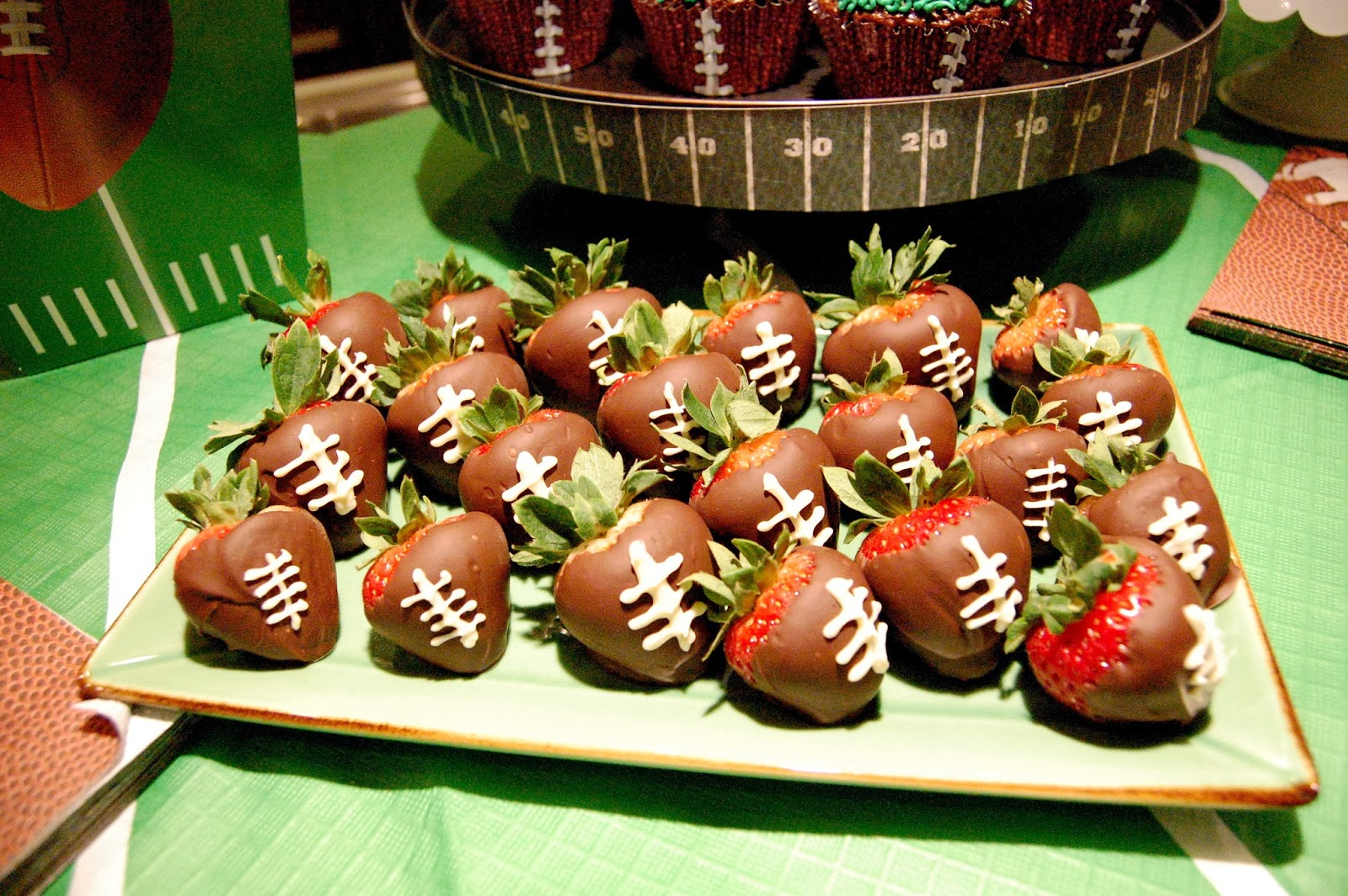 Yum! Chocolate covered strawberry footballs. I think I ate half of ...