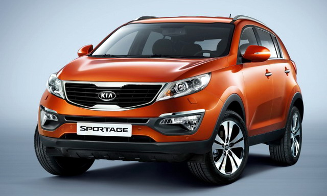 Front 3/4 view of orange 2011 Kia Sportage
