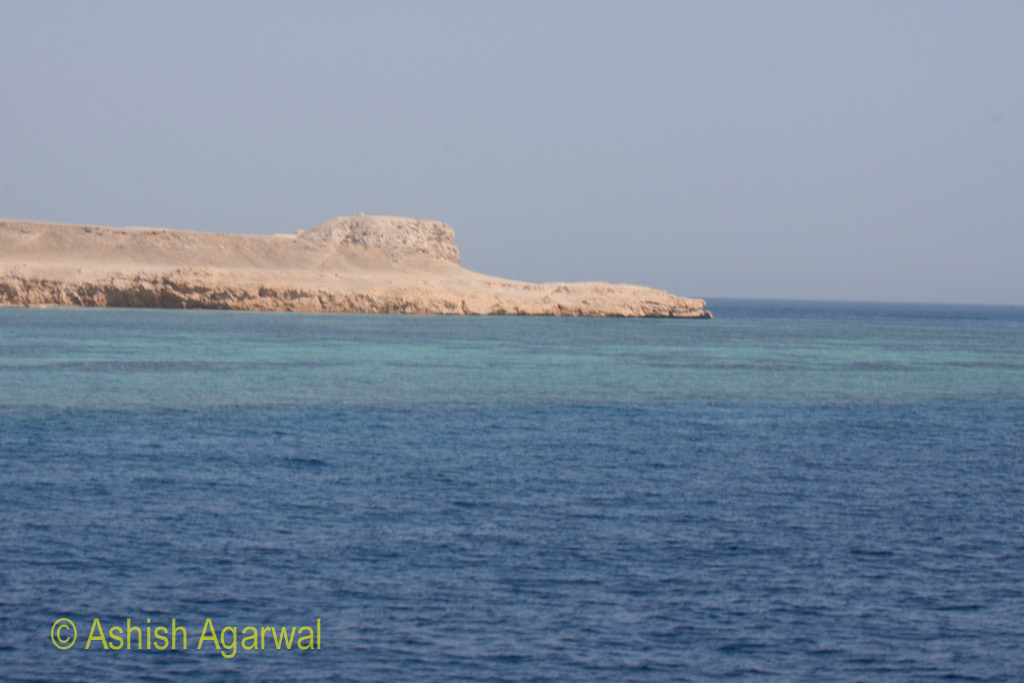 Shoreline near Sharm el Sheikh in Egypt with coral reefs below water in the Red Sea
