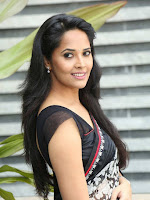 Anasuya in Black Saree Stills-cover-photo