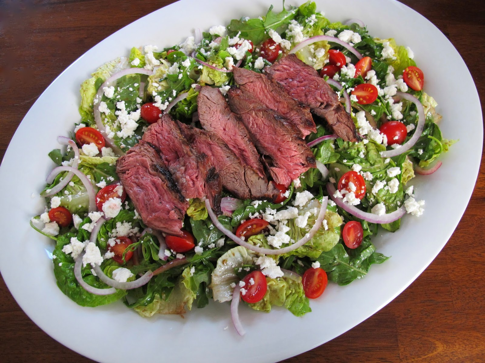 Grilled Skirt Steak Salad with Arugula, Little Gems, Grape Tomatoes, Red Onion, Goat Cheese